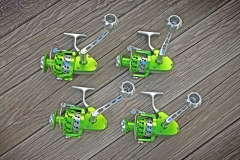Green-and-Silver-Reels-on-Wood